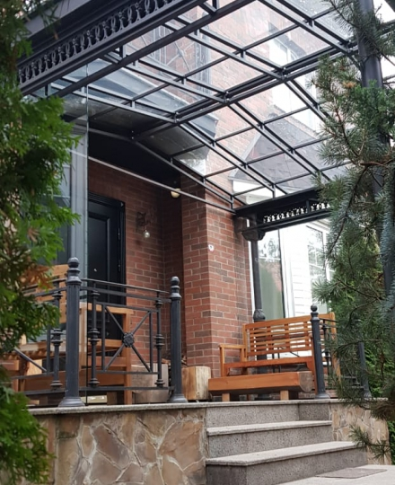 Cast iron canopy over the entrance with a glass roof